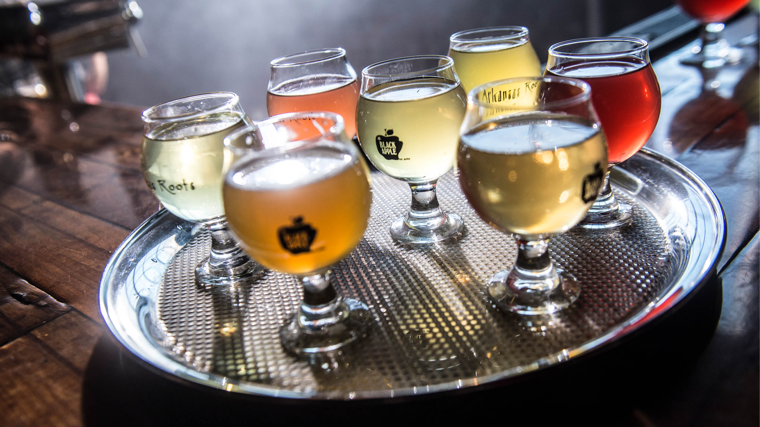 A tray of glasses filled with cider from Black Apple Hard Cider
