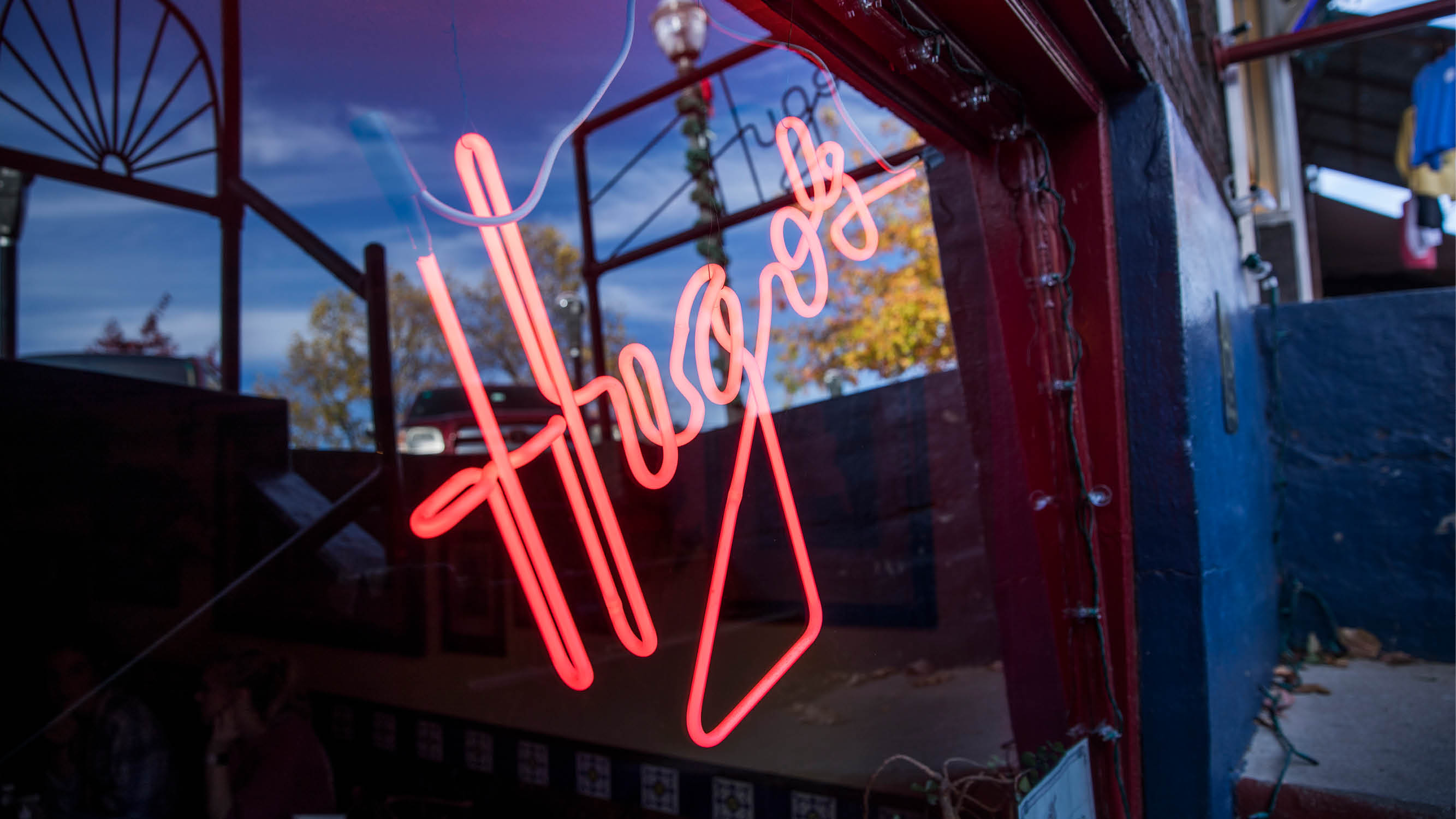 The neon sign in the front window of Hugo's near Lake Fayetteville