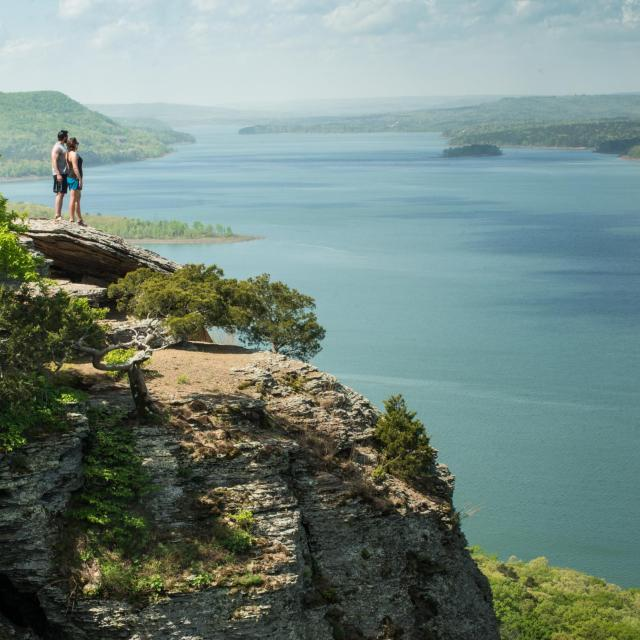 A couple hiking at Sugar Loaf Mountain overlooking Fairfield Bay
