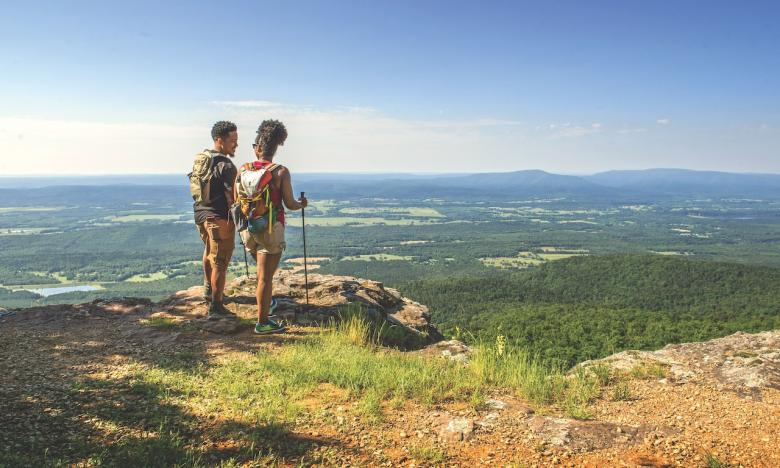 Hikers enjoy the view at Mount Magazine