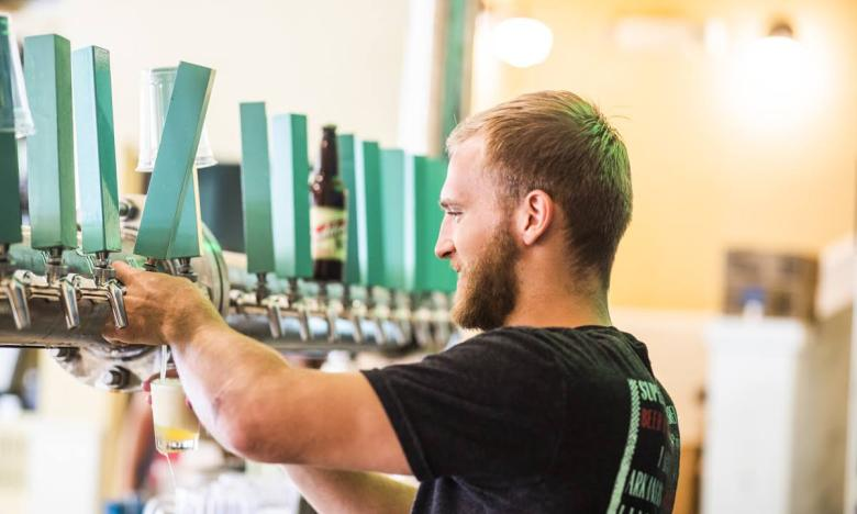 Get a pint from one of the 18 rotating taps at Superior Bathhouse Brewery