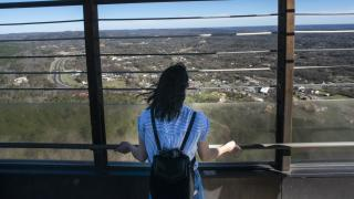 Woman views scenery from the Hot Springs Mountain Tower.