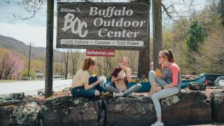 Friends eating deli sandwiches from Buffalo Outdoor Center in Arkansas