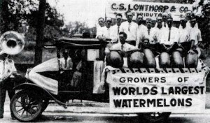 1927 - Entry in the 1927 Parade. Mr. Lowthorp created the Hope market for giant watermelons through business and railroad convention contacts in the off-season. These men of Rocky Mound and Shover Springs supplied him with the giants for his sales. The group included four men who grew world record giant watermelons. Arthur Powell grew the winning melon for 1927 in the Rocky Mound community. Photo Courtesy of the Hope Star
