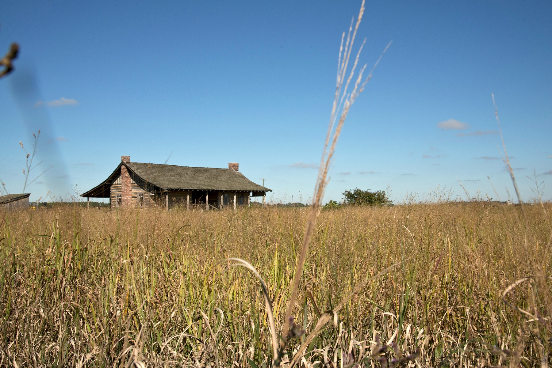 The 1877 dog trot log cabin stands less than half a mile from where it was originally built.