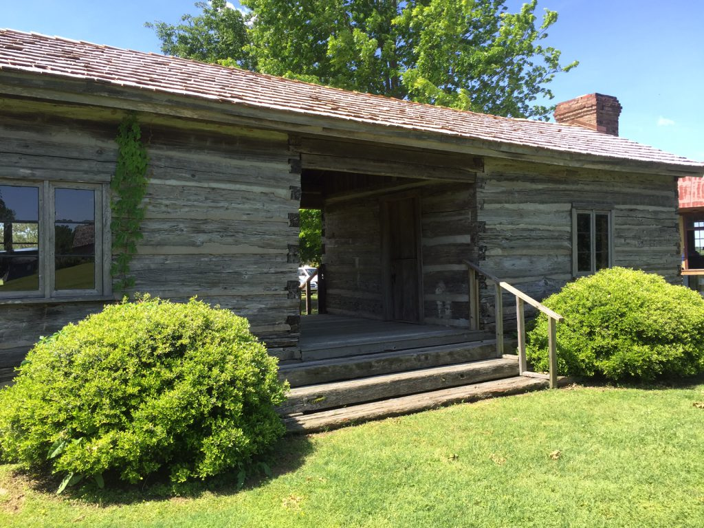 The Ashley-Alexander Log Dogtrot House, circa 1840, is the oldest original structure at the Settlement. The house is full of artifacts that exemplify its history, including raw cotton, spinning wheel and loom, as well textiles and home decor made of cotton. Kids can try a hand at cleaning cotton to see how much work it was. If you have a big enough group, you can see what it feels like to cram 18 kids into one room; an owner of a house this size could easily have had that many, and they all had to sleep somewhere—hopefully some of them in an additional loft space!